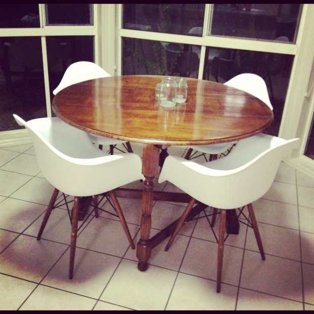 Antique table with Eames Eiffel Wing Shell chairs