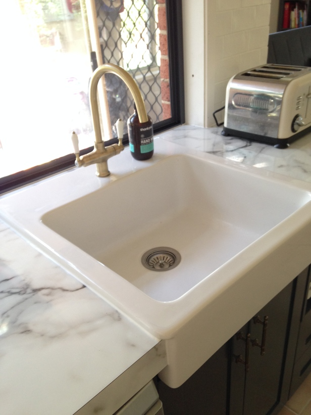 Ah my sink & brass tap.